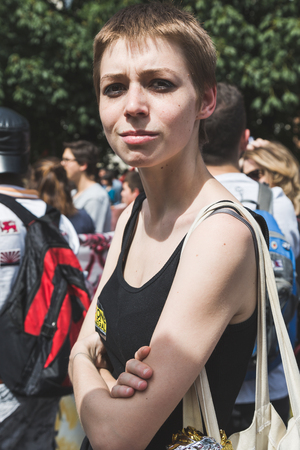 MILAN, ITALY - MAY 20, 2017: One hundred thousand people take part in a peaceful demonstration laying claim to rights and hospitality for immigrants and refugees.