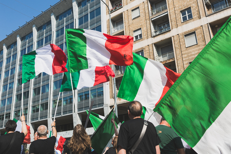 MILAN, ITALY - MAY 27, 2017: Far-right activists march in the city streets protesting against the rampant immigration and demanding more support for Italian citizens.