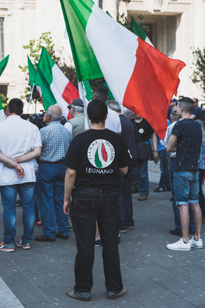 rightwing: MILAN, ITALY - MAY 27, 2017: Far-right activists march in the city streets protesting against the rampant immigration and demanding more support for Italian citizens.