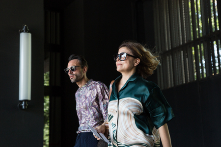 MILAN, ITALY - JUNE 17: Fashionable people pose outside Neil Barrett fashion show during Milan Mens Fashion Week on JUNE 17, 2017 in Milan. Editorial