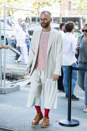 barrett: MILAN, ITALY - JUNE 17: Fashionable man poses outside Neil Barrett fashion show during Milan Mens Fashion Week on JUNE 17, 2017 in Milan.