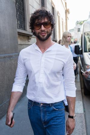 MILAN, ITALY - JUNE 17: Fashionable man poses outside Les Hommes fashion show during Milan Mens Fashion Week on JUNE 17, 2017 in Milan. Editorial