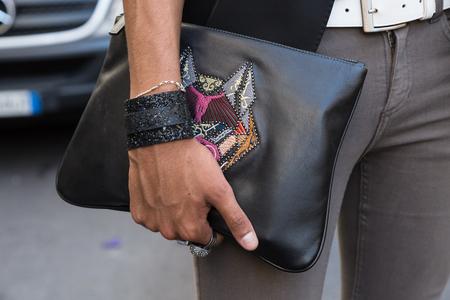 MILAN, ITALY - JUNE 17: Detail of bag outside Les Hommes fashion show during Milan Mens Fashion Week on JUNE 17, 2017 in Milan. Editorial