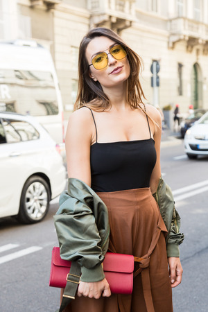 MILAN, ITALY - JUNE 17: Fashionable woman poses outside Les Hommes fashion show during Milan Mens Fashion Week on JUNE 17, 2017 in Milan. Editorial