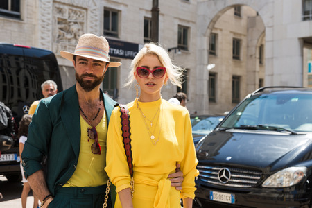 MILAN, ITALY - JUNE 18: Fashionable people gather outside Ferragamo fashion show during Milan Mens Fashion Week on JUNE 18, 2017 in Milan.