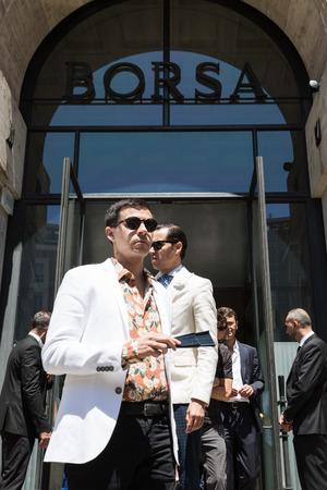 MILAN, ITALY - JUNE 18: Fashionable man poses outside Ferragamo fashion show during Milan Mens Fashion Week on JUNE 18, 2017 in Milan.