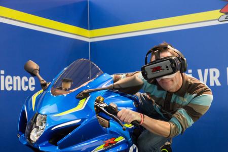 MILAN, ITALY - NOVEMBER 7: Man tries virtual reality headset at EICMA, international motorcycle exhibition on NOVEMBER 7, 2017 in Milan.