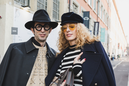 MILAN, ITALY - JANUARY 14: Fashionable people pose outside Federico Curradi fashion show during Milan Mens Fashion Week on JANUARY 14, 2018 in Milan.