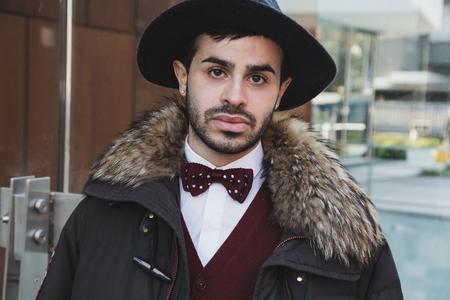 MILAN, ITALY - JANUARY 14: Fashionable man poses outside Federico Curradi fashion show during Milan Mens Fashion Week on JANUARY 14, 2018 in Milan.