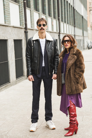 MILAN, ITALY - JANUARY 15: Fashionable people pose outside Armani fashion show during Milan Mens Fashion Week on JANUARY 15, 2018 in Milan.