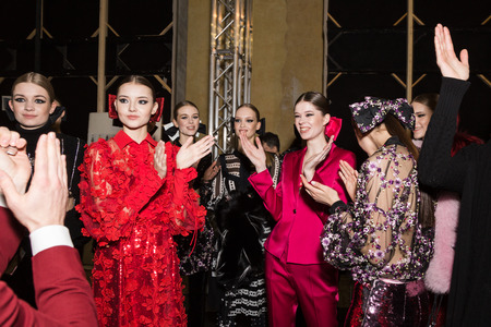 MILAN, ITALY - FEBRUARY 25: Gorgeous models pose in the backstage just before Piccione.Piccione show during Milan Women's Fashion Week on FEBRUARY 25, 2018 in Milan.