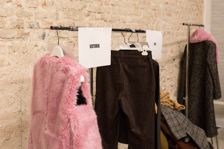 MILAN, ITALY - FEBRUARY 25: Clothes rack in the backstage just before Au Jour le Jour show during Milan Womens Fashion Week on FEBRUARY 25, 2018 in Milan.