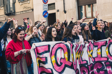 MILAN, ITALY - MARCH 8: Secondary school students take part in a march to celebrate the International Womes Day on MARCH 8, 2018 in Milan.