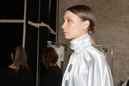 MILAN, ITALY - SEPTEMBER 19: Beautiful model poses in the backstage just before Alberto Zambelli show during Milan Womens Fashion Week on SEPTEMBER 19, 2018 in Milan. Editorial