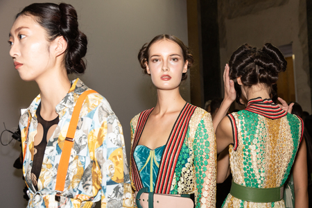 MILAN, ITALY - SEPTEMBER 23: Beautiful models pose in the backstage just before Francesca Liberatore show during Milan Women's Fashion Week on SEPTEMBER 23, 2018 in Milan. Editorial