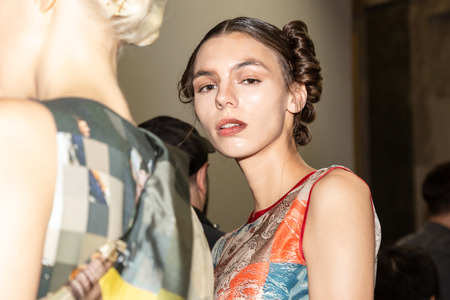 MILAN, ITALY - SEPTEMBER 23: Beautiful model poses in the backstage just before Francesca Liberatore show during Milan Womens Fashion Week on SEPTEMBER 23, 2018 in Milan. Editorial