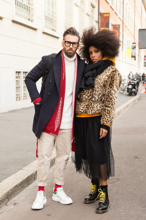 MILAN, ITALY - JANUARY 12: Fashionable couple poses outside Magliano fashion show during Milan Mens Fashion Week on JANUARY 12, 2019 in Milan.