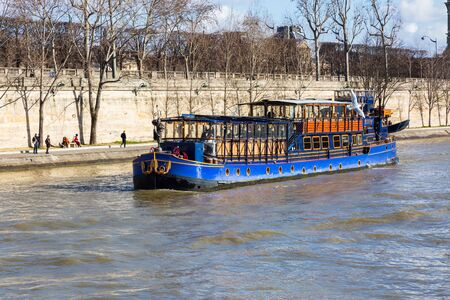 seine: Blue boat on Seine river