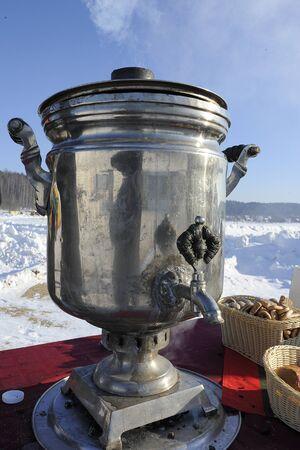 snowy field: boiling samovar in a snowy field