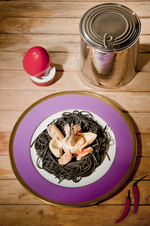 tableware life: black pasta with seafood on a plate purple