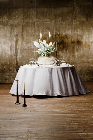 round table: wite round table with artificial flowers