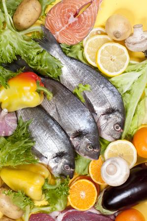 dorado fish: Three fresh dorado fish among the fruits and vegetables