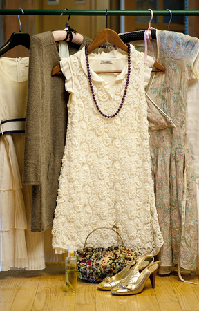 walk in closet: still life with a womans holiday wardrobe in the form of summer dresses