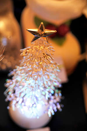 plastic christmas tree: plastic Christmas tree with a gold star Stock Photo