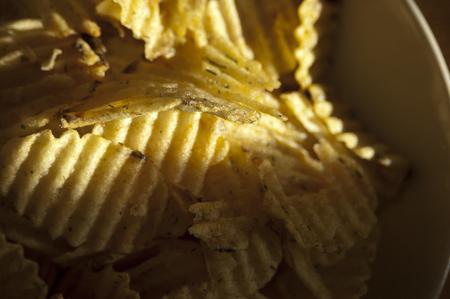 Ribbed potato chips illuminated by the sun