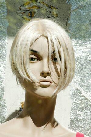 mannequin head: blonde mannequin head illuminated by the sun.