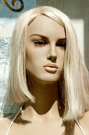 mannequin head: blonde mannequin head illuminated by the sun