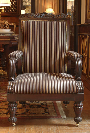 Upholstered With A Striped Fabric Armchair With Armrests And Carved Legs