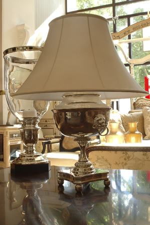 lampshade: desk lamp with a white lampshade stands on the table