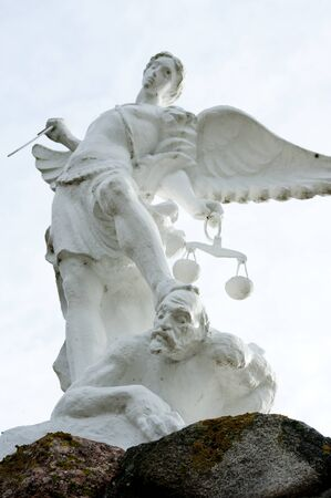 tribunal: Sculpture of white angel criminal justice with his sword
