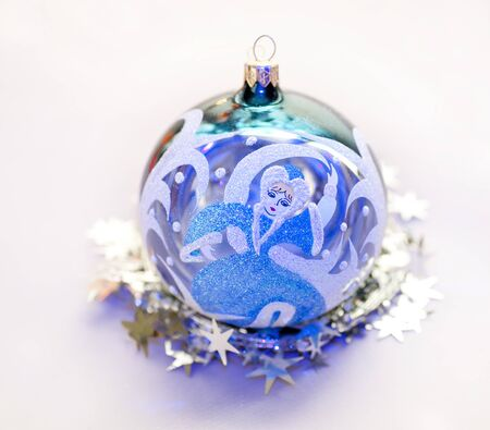 snow maiden: Christmas toy in the shape of a ball with a picture of Snow Maiden Stock Photo