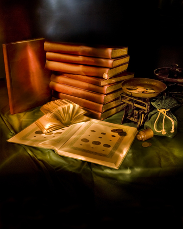 numismatic: Still Life with weights, coins and numismatic catalogs