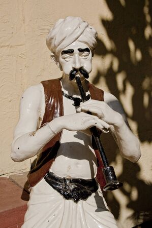 charmer: outdoor sculpture of a snake charmer in Mumbai