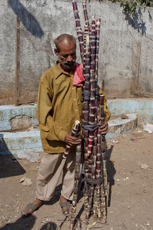 merchandiser: sugar cane seller in the streets of Mumbai