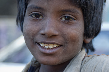 beggars: boy face beggars in the Pakistani city of Karachi Editorial