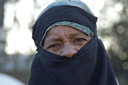 burqa: eyes of an elderly woman in a burqa on the street in Karachi
