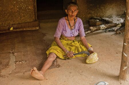 assignments: woman reveals coconut iron hatchet