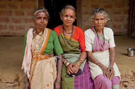 indian village: Three elderly women sitting on the bench in the Indian village