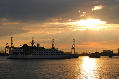 cruise liner: Cruise liner sailing during sunset at a port In Malaysia