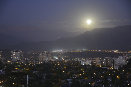 citylight: moon rise at mount andes in Santiago, Chile
