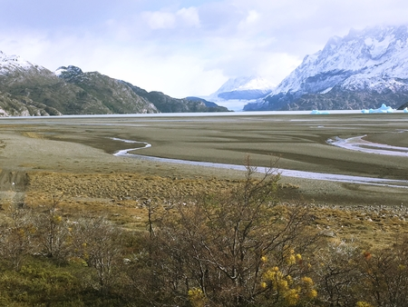 landscape of lake, mountains and bridge in Patagonia Chile Stock Photo
