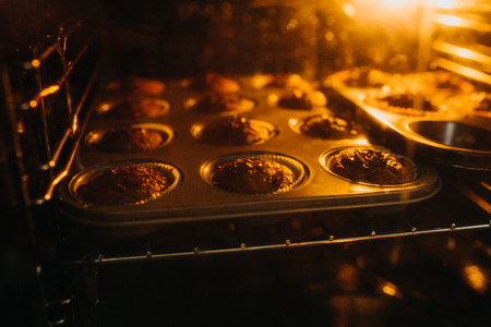 carob muffins in an oven Stock Photo