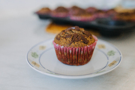 carob muffin on a white plate Stock Photo