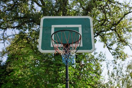 wooden green basketball basket outside