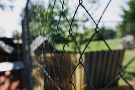 selective focus on outdoor chain link fence