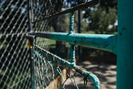 old rusty chain fence gate with lock open